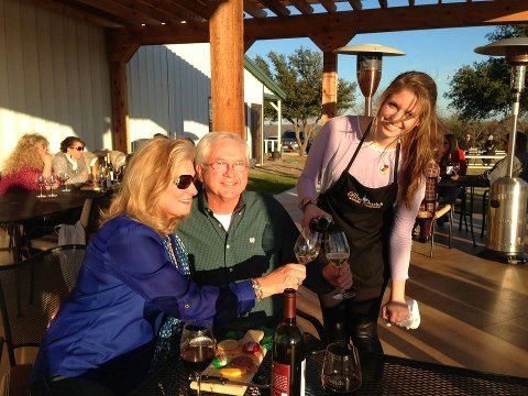 Presley Whitehead serves guests on the pergola covered wine deck